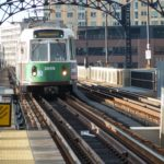 A Green Line train pulls into the subway station, my destination is the Four Seasons, Boston on Boylston Street.