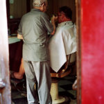 At the Barbers by Ivan Azzopardi