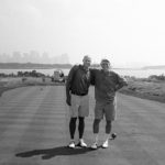 Dris Upitis and father Alvis Upitis on the 14th tee of Liberty National Golf Course in August 2009, 59 years after Alvis entered New York Harbor as an immigrant in the arms of his father.