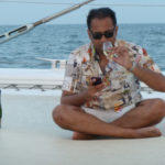 The author with champagne and Blackberry while taking a sunset cruise on the Arabian Sea