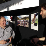 Jim Wagner of Leica chatting with a festival attendee