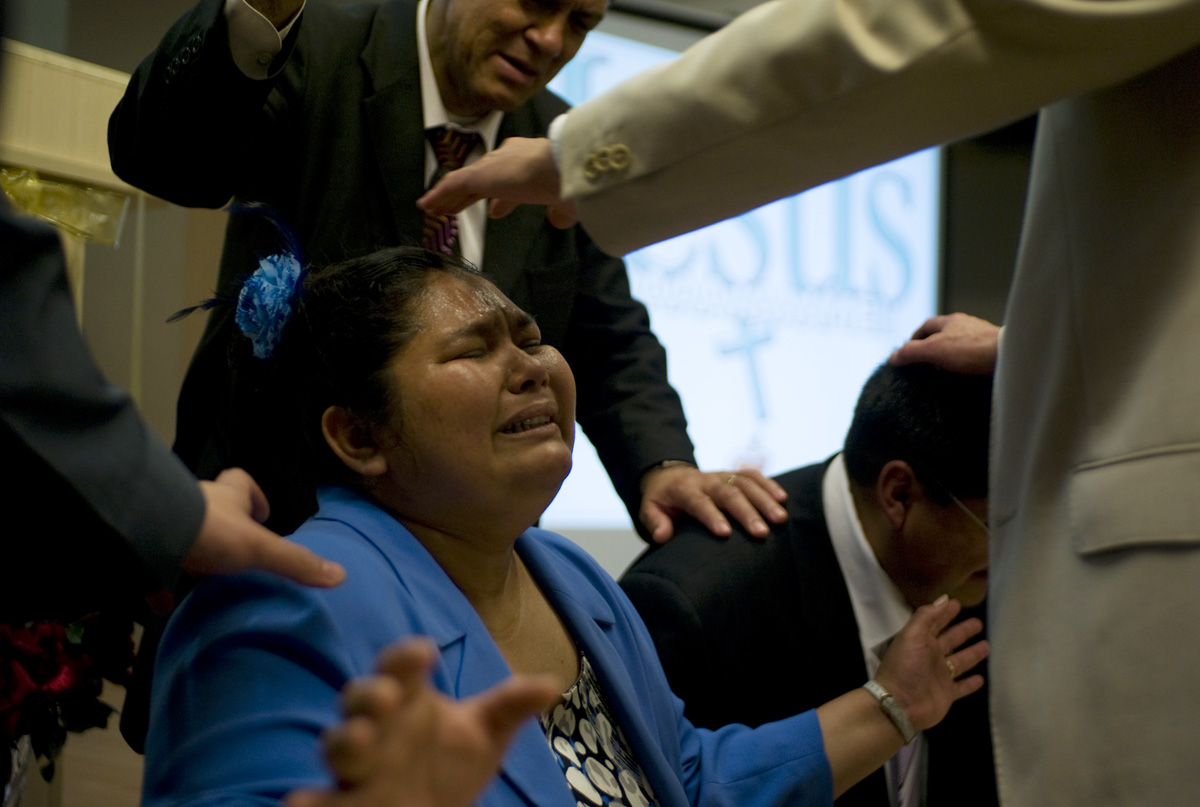 One of the leaders of a new Pentecostal church in Spain receives a blessing. © Damaso Reyes