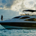 The ridiculous – a multi-million dollar yacht (with yours truly perched at the bow)