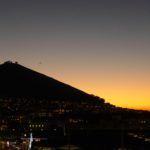 Signal Hill and the Lion's Head dominate the skyline at sunset.