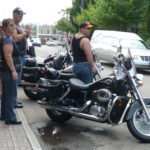 Leather-clad bikers in Baie St Paul...note the hearse in the background.