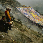 Tibetan pilgrims at 'Thangka' unveiling at the annual Shoton Festival. © Justin Guariglia
