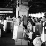 "Baggage claim area after June 25, 1950 arrival in New York Harbor. Note ""U"" on two boxes for Upitis."