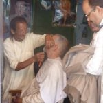 Barbers still use cut-throat razors in India. The author was NOT next in line!