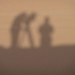 My film crew silhouetted against the desert sand