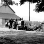 My brother Ilmars with me on tractor at Empire Farm in Copake, NY in 1950.