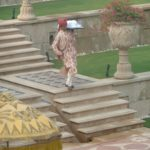 A waiter delivering towels to the Amarvilas swimming pool