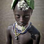 Karo Boy with Flower- Omo Valley Region, Ethiopia; Taken with a Leica M9 by William Palank