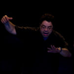 A composite image of Arturo O'Farrill conducting.
