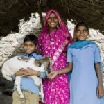 Heifer group member and two of her children. Photo taken by Brigitte Lacombe.