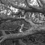 Isaac, Sasha exploring a fallen tree © David G. Spielman