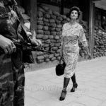 "Sarajevo - A City Under Siege © Tom Stoddart/Getty Images | In the dangerous suburb of Dobrinja, Meliha Vareshanovic walks proudly and defiantly to work during the siege of Sarajevo, 1993. Her message to the watching gunmen who surround her city is simple, ""you will never defeat us."""