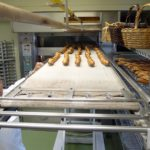 Master Baker Matt McDonald at the Bouchon Bakery pulls bread from the oven at high-speed