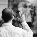 The Hand: a parishioner at a multicultural church stands during a service