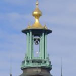 The top of the tower at Stockholm City Hall. The three crowns are a symbol of Sweden and appear in the coat of arms.