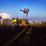 A cowboy gets thrown off a bull at a rodeo in Southern Alberta. © Todd Korol