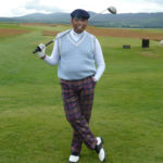 Author readies himself for a round of golf. Tartan trousers, peaked cap, cigar and driver. All the gear...no idea! By Varun Sharma