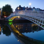 Ha' Penny Bridge and the Liffey River in Dublin by Tom Grill