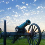 Cannon with sun burst at dawn, Gettysburg by Tom Grill