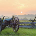 Cannon and fence at sunrise in Gettysburg Nationl Military Park by Tom Grill
